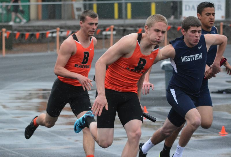 by: TIMES PHOTO: MATT SINGLEDECKER - Beaverton's Stephen Marcille and Ross Hoffman helped the Beavers 4x100 relay beat Westview on April 23. The Beavers short relay has the second best time in Metro.