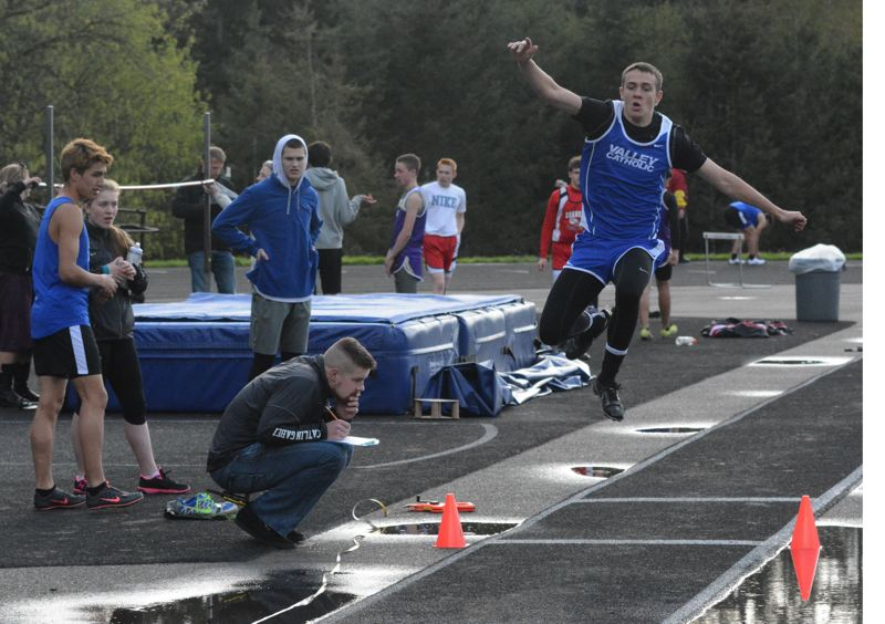by: TIMES PHOTO: MATT SINGLEDECKER - Valley Catholic junior JD Menkens won the triple jump and helped both Valiant relays place second overall.