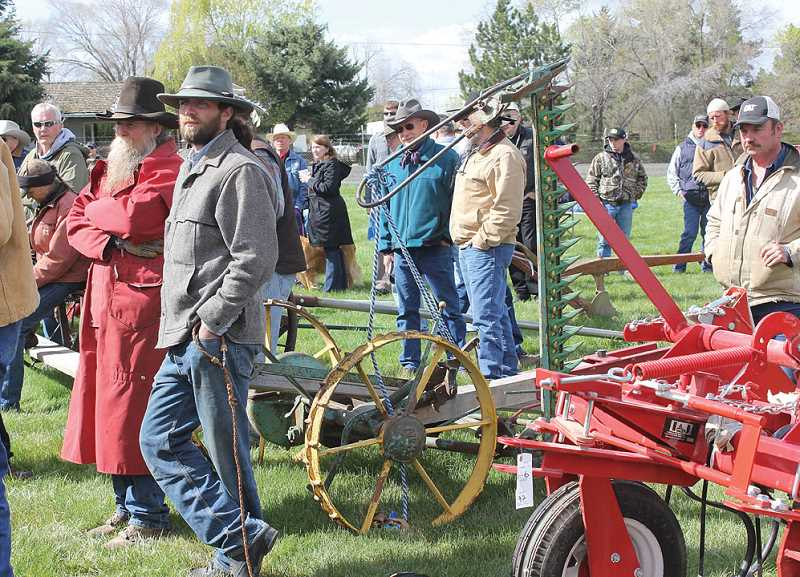 by: SUSAN MATHENY - A crowd gathers on Friday waiting for the horse-drawn farm implements sale at the Small Farmers Journal auction.