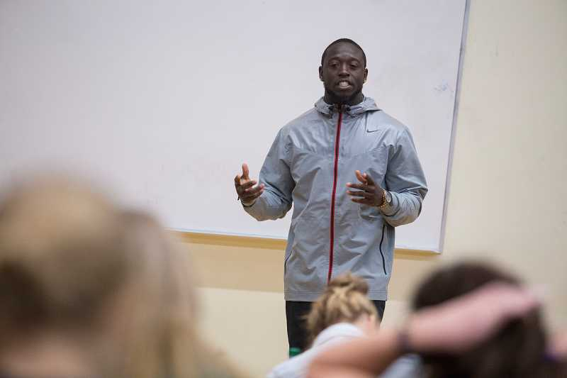 by: TIMES PHOTO: JONATHAN HOUSE  - De'Anthony Thomas gives a talk with a Beaverton High School marketing class during an appearance on Monday.