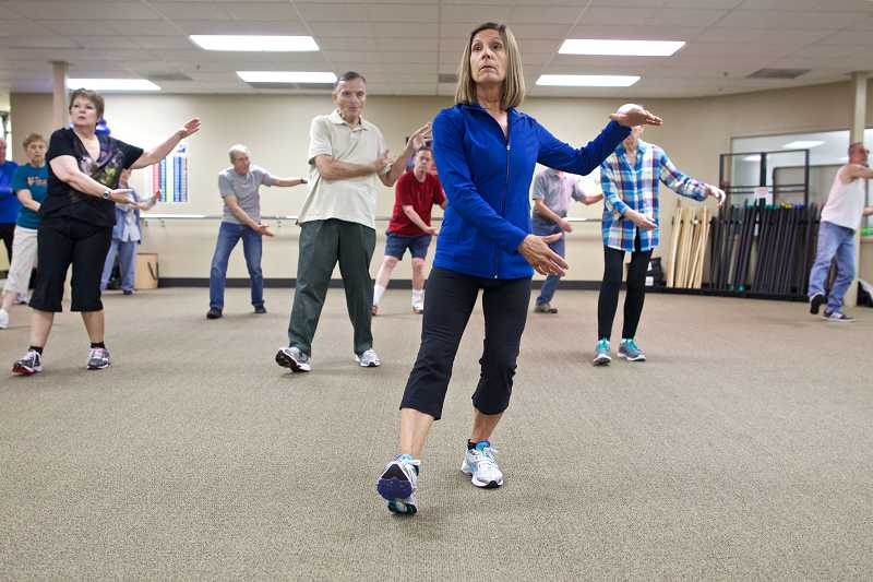 by: TIMES PHOTO: JAIME VALDEZ - Tigard resident Nancy Nelson is a fitness specialist and personal trainer who uses exercise to help people with Parkinsons disease. Studies show that exercise may help stave off some of Parkinsons symptoms by forming new pathways in the brain.