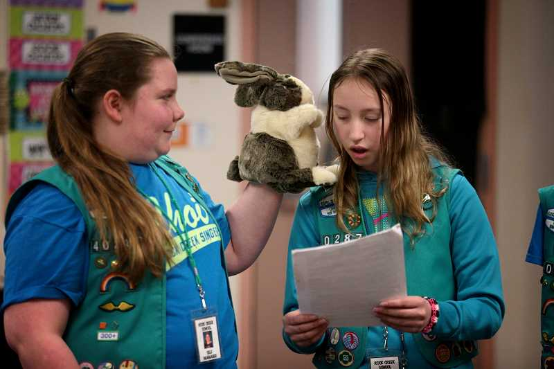 by: TIMES PHOTO: JONATHAN HOUSE - Disaster puppet Ready Rabbit shares tips with Girl Scout Junior Eleni Kandas during a presentation at Rock Creek Elementary School on Thursday, April 24.