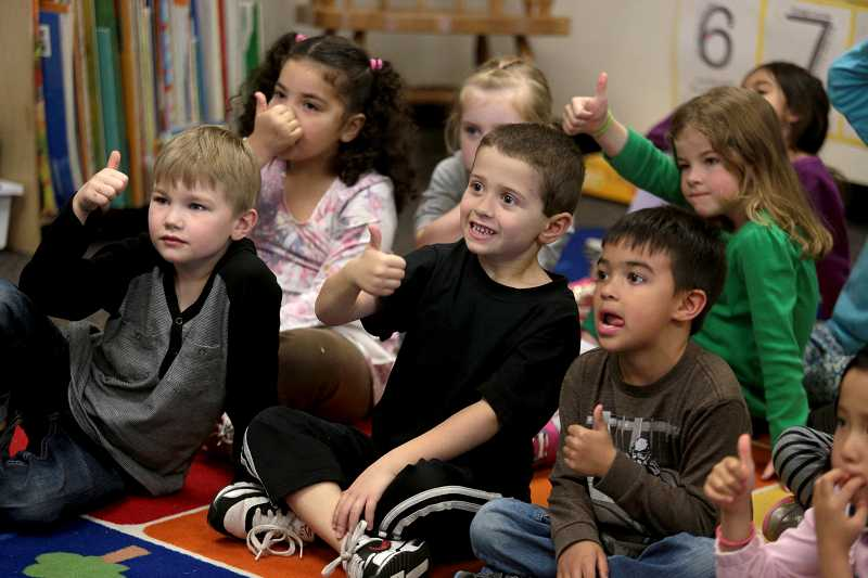 by: TIMES PHOTO: JONATHAN HOUSE - Rock Creek Elementary School kindergartners give a thumbs up to proper emergency preparedness during a Girl Scout presentation on fires, earthquakes and winter emergency preparedness at the school.