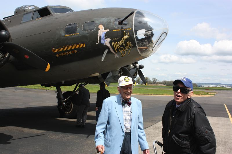 by: HILLSBORO TRIBUNE PHOTO: DOUG BURKHARDT - Veterans James Miller (right), 91, and Howard Bunker, 93, share a laugh before taking a flight on the Memphis Belle. Miller, a Hillsboro resident, was a B-17 tail gunner in World War II, while Bunker, who lives in Portland, served as a radio operator on the iconic bombers.