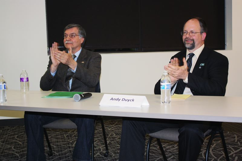 by: HILLSBORO TRIBUNE PHOTO: DOUG BURKHARDT - Washington County Chairman Andy Duyck (right) and challenger Allen Amabisca talk about the issues at a recent candidates forum in Hillsboro.