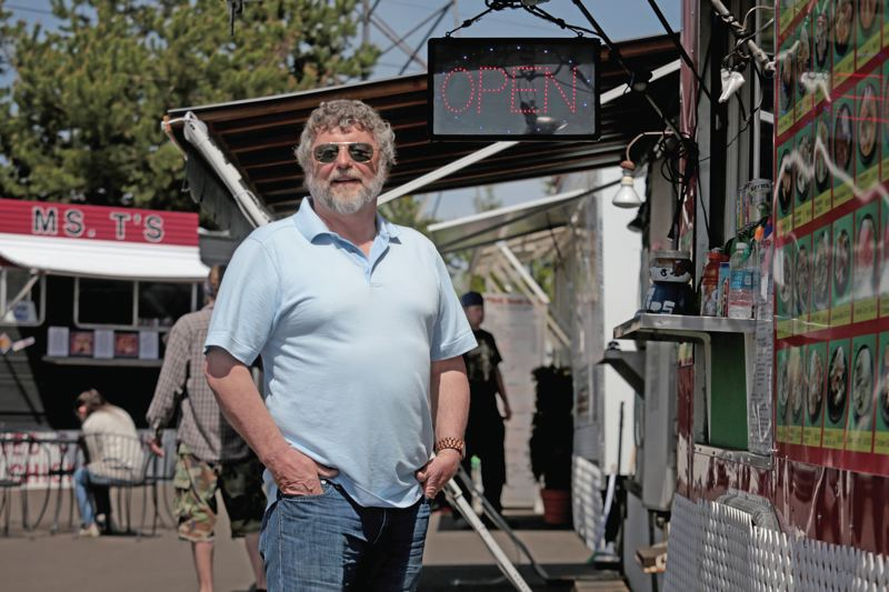by: TRIBUNE PHOTOGRAPHY: JONATHAN HOUSE - Cartlandia owner Roger Goldingay paved the way for eastside food carts pods with the development of Mississippi Marketplace. He intentionally designed the site as a community space.