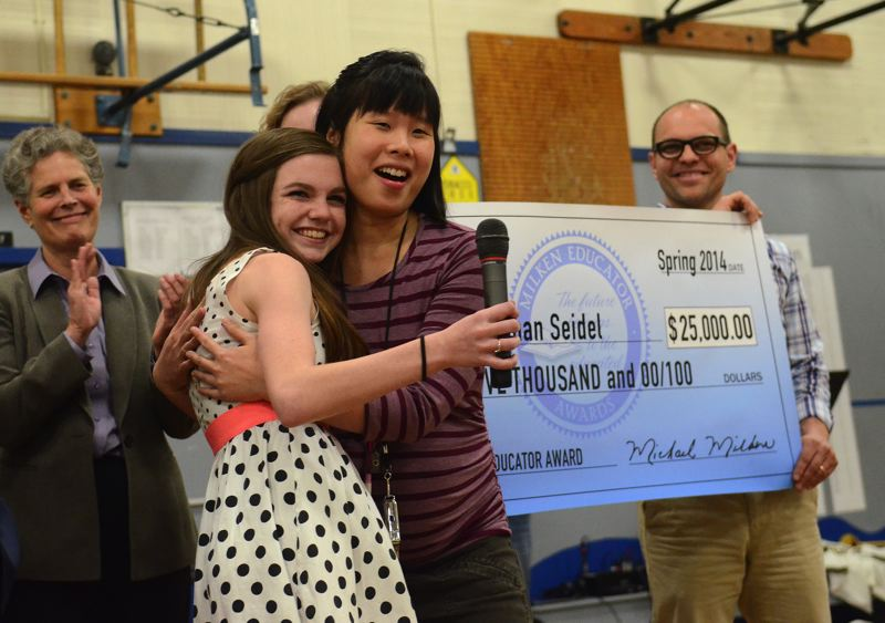 by: CONNECTION PHOTO: VERN UYETAKE - Teresa Chan Seidel embraces a former student shortly after learning she has won the Milken Educator Award - and $25,000.