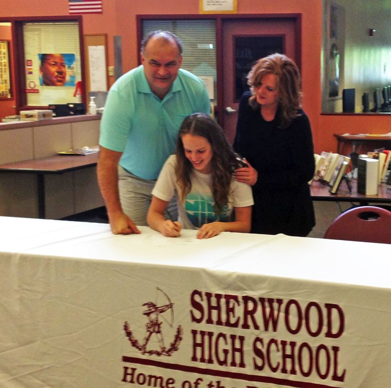 by: SUBMITTED PHOTO - TO TEXAS -- Sherwood High School senior Alex Hubbard signs her letter of intent to attend West Texas A&M on a volleyball scholarship.
