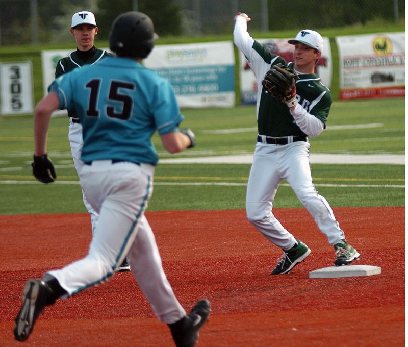 by: DAN BROOD - TRYING TO TURN TWO -- Tigard senior second baseman Bruin Campbell (right) looks to make a throw to first after forcing Century's Nate Rau out at second base.