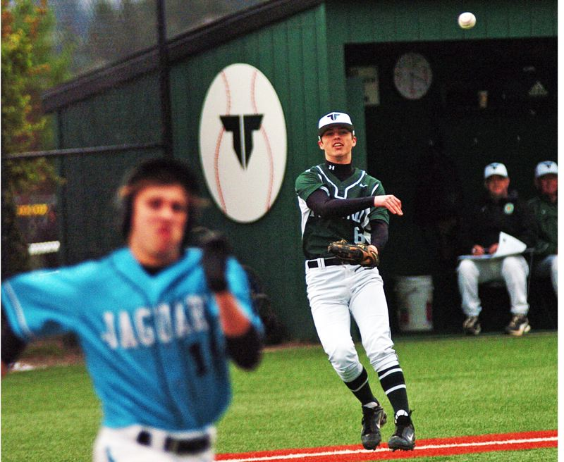 by: DAN BROOD - WEB GEM -- Tigard senior third baseman Jesse Bye makes a throw to first after making a running, bare-handed grab of a Century bunt.