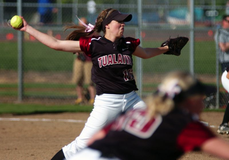 by: DAN BROOD - NO-HIT PITCHER -- Tualatin High School junior Emily Sorem gets ready to fire a pitch to the plate during the Timberwolves' 8-0 victory at Tigard on Tuesday. Sorem pitched a no-hitter in the victory, striking out 13 and walking two.