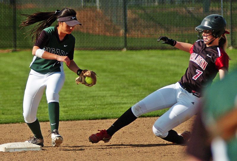 by: DAN BROOD - OUT AT SECOND -- Tigard junior second baseman Kayla Saldana (left) forces out Tualatin sophomore Camryn Robbins in Tuesday's game.