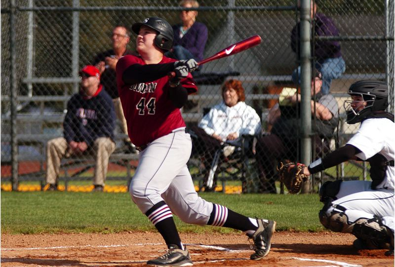by: DAN BROOD - HOME RUN SWING -- Sherwood High School senior Travis Kotowski watches the ball take off as he blasts a two-run first-inning home run for the Bowmen in their 8-1 win at St. Helens on Monday.