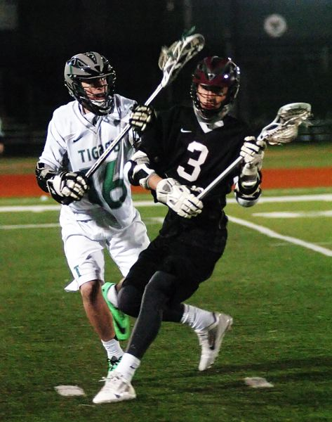 by: DAN BROOD - ON THE ATTACK -- Tualatin sophomore Hayden Hupfer (3) looks to move the ball ahead against Tigard.