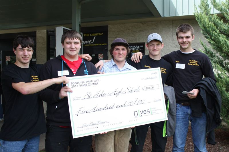 by: COURTESY OF OREGON OSHA - Students from St. Helens High School hold up a giant $500 check - their prize money for placing first in a worker safety video contest - outside the Northern Lights Theatre in Salem on Saturday, April 26.