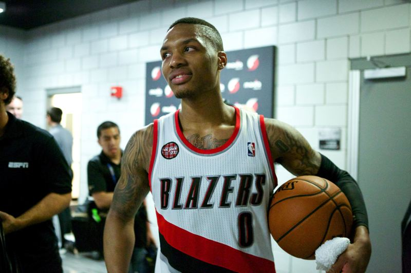 Damian Lillard heads to the Portland locker room after making the last-second 3-pointer that  beat Houston 99-98.