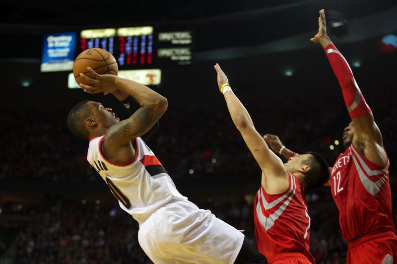 Damian Lillard shoots over Jeremy Lin and the Rockets during the second half.