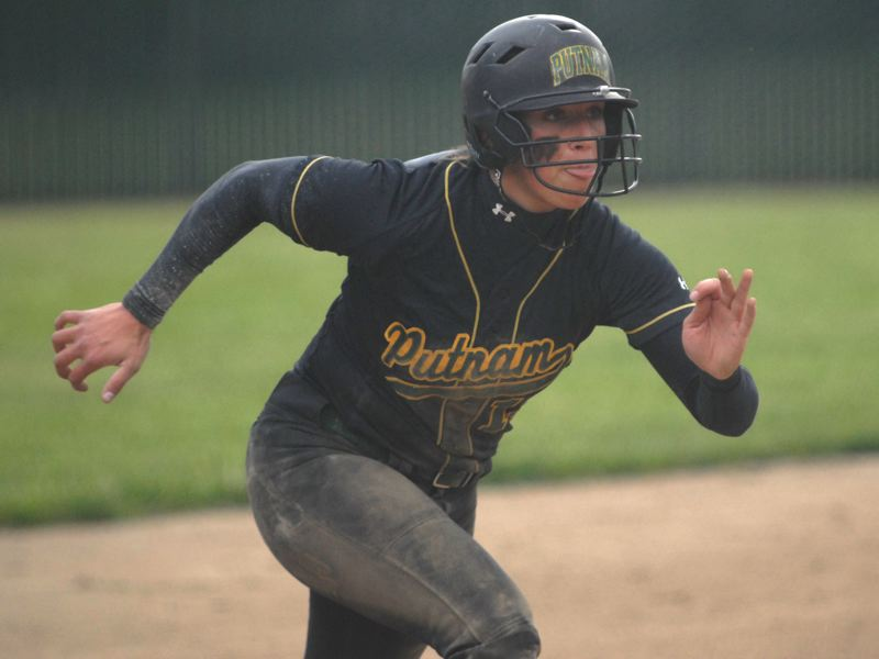 by: PAMPLIN MEDIA GROUP: DAVID BALL - Putnams Ashley Culp breaks from third base on her way to scoring the winning run in the sixth inning of Fridays 3-1 win over Sandy.