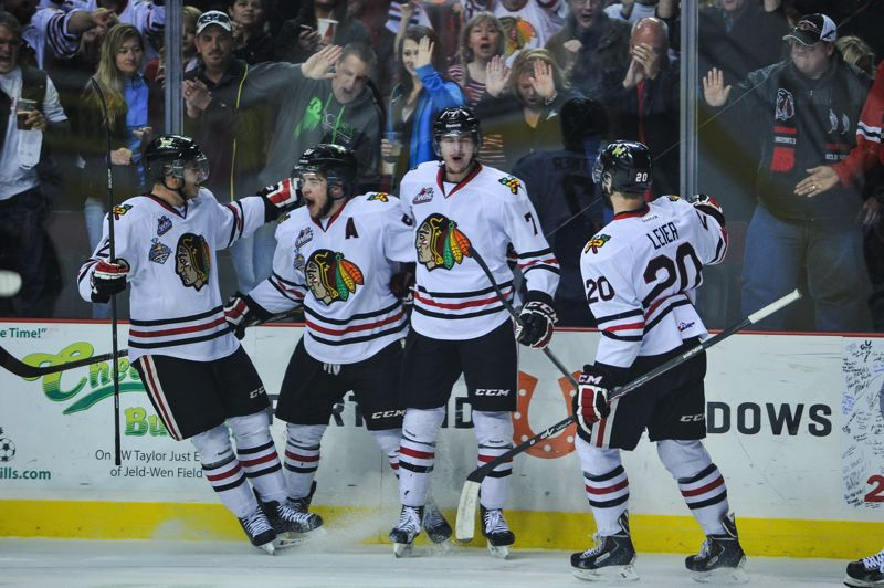 by: COURTESY OF JOHN LARIVIERE - Portland Winterhawks (from left) Anton Cederholm, Derrick Pouliot, Paul Bittner and Taylor Leier celebrate Bittner's goal in the first period Saturday at Moda Center.