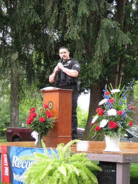 by: GAZETTE PHOTO: RAY PITZ - Sherwood Captain Ty Hanlon reminds residents of the police officers who have died over the years in the line of duty. National Police Week is May 11-17.