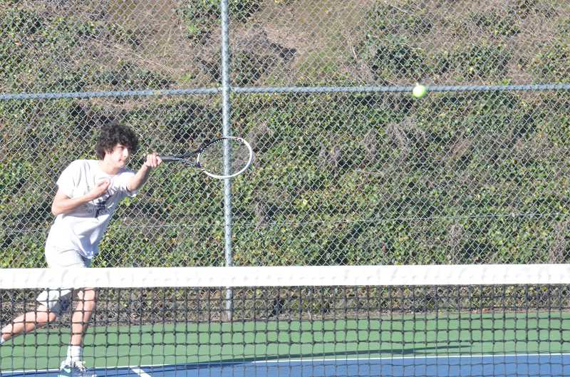 by: JEFF GOODMAN / FILE - Quinn Everts and the Wilsonville boys tennis team won their first 10 matches in Northwest Oregon Conference play. The Wildcats are two victories away from a perfect league record.