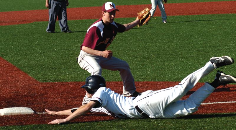 by: SANDY POST: PARKER LEE - Sandys Bryce Tilton safely dives back to third base during Fridays home win over Milwaukie.