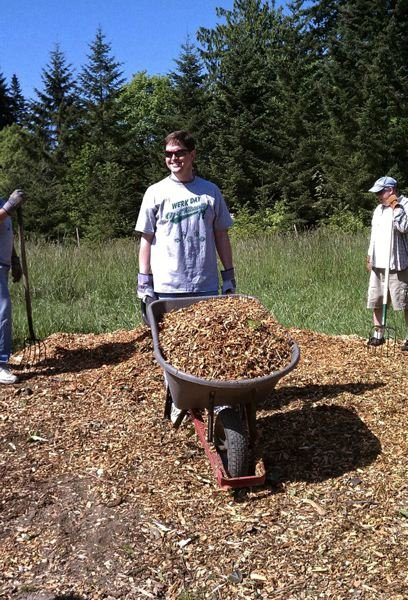 by: SPOKESMAN FILE PHOTO - City Councilor Richard Goddard participates in a recent Wilsonville WERK Day, a community-based effort that cleans local parks and public properties.