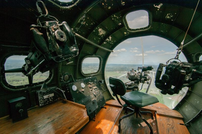by: SPOKESMAN PHOTO: JOSH KULLA - The nose armament in the B-17F consisted of a pair of Browning .50 caliber heavy machine guns. The bombardier sat at the table to the left when he wasn't busy aiming his plane's payload at targets in France, Germany and Belgium.