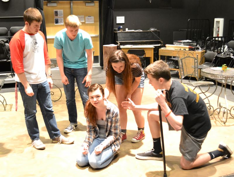 by: PHOTO COURTESY: SCOTT WALKER - Playing a housewife, sophomore Tawnie McAlister reacts after finding out her cat was trampled by a rhino. In the background, from left, are Josh White, Kane Reynolds, Laura Eggersgluss and Jonathan Hausler.