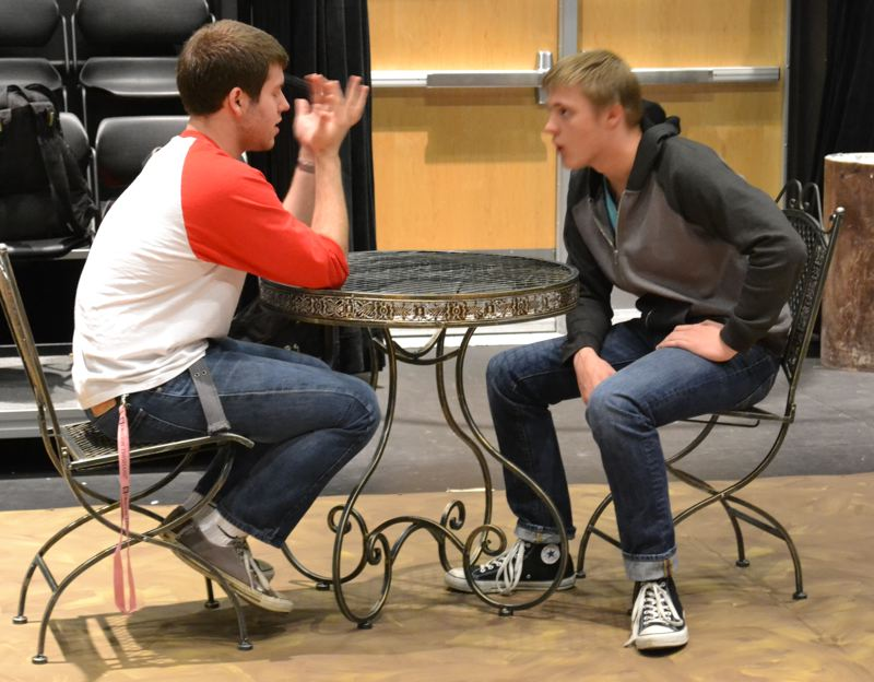 by: PHOTO COURTESY: SCOTT WALKER - Characters played by Milwaukie High School juniors Josh White and Kane Reynolds sit down to argue in a play about how the Nazi party took control in France.
