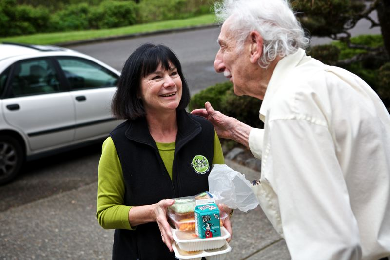 by: TRIBUNE PHOTO: JAIME VALDEZ - Meals on Wheels People Executive Director Joan Smith delivers a dinner to a Northwest Portland resident (who declined to be identified). Smith says the nonprofit has applied for Children's Levy funds to provide evening meals to low-income children.
