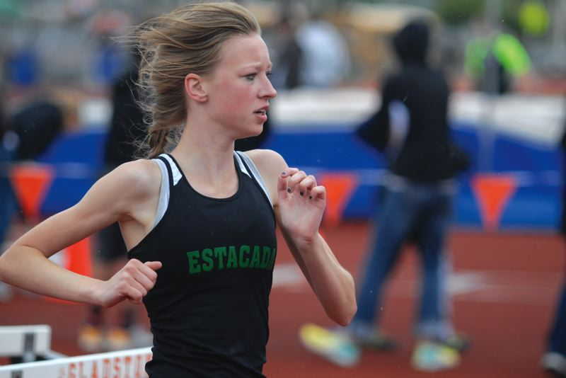 by: ESTACADA NEWS: DAVID BALL - Estacadas Mariah Johnson keeps her focus around the corner during her third-place finish in the 3,000-meter race at Saturdays Dick Baker Invitational.