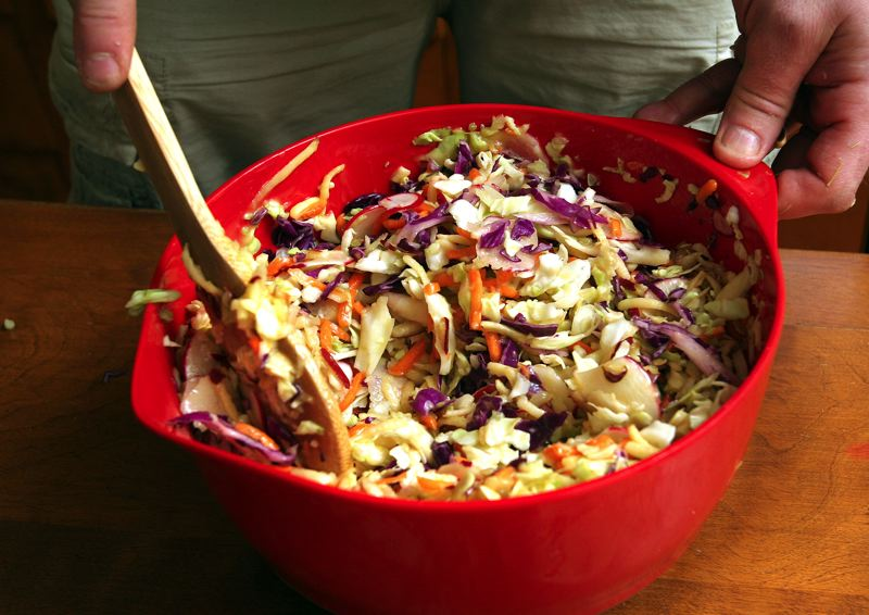 by: OUTLOOK PHOTO: JIM CLARK - Most folks would refer to Bissell's Fresh Seven Ingredient Salad as coleslaw, but the side dish is a refreshing blend of julienned apples, vegetables and a super secret honey mustard dressing Bissell makes from scratch.