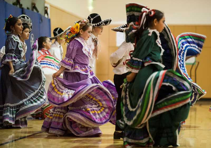 by: SPOKESMAN PHOTOS: JOSH KULLA - The Folklorico dancers' colorful dresses were in constant motion during dances the group performed during the Day of the Children celebration.