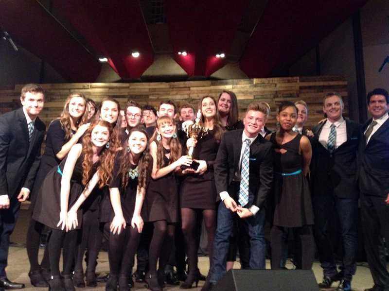 by: SUBMITTED PHOTO - Soul'd Out members are all smiles as they hold their trophy Saturday night. The Wilsonville High School a cappella group took first place at Portland's Rose City Sing Off for the third year in a row.