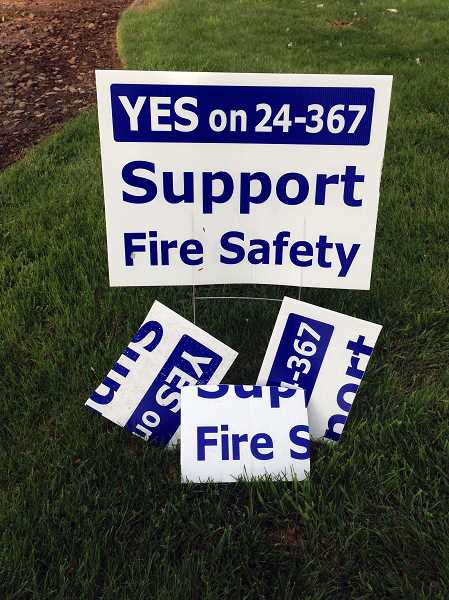 by: SUBMITTED PHOTO - The vandalized remains of at least three campaign signs were found near the intersection of Ehlen and Donald roads last week. An estimated 25 additional signs have been stolen.