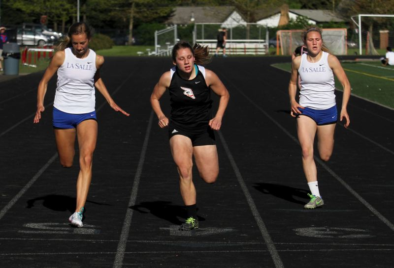 by: JON HOUSE - Senior Kelsey Hathaway was a bright spot for Gladstone in last weeks dual loss to La Salle. Pictured above, Hathaway (center) edges La Salle sprinters Talya Holenstein (left) and Claire Primack for first place in the 200-meter dash. Hathaway also won the 100 in a career-best time of 12.91 and the triple jump, at 32-1-1/4. Primack got the best of Hathaway in the long jump, winning by three fourths of an inch.