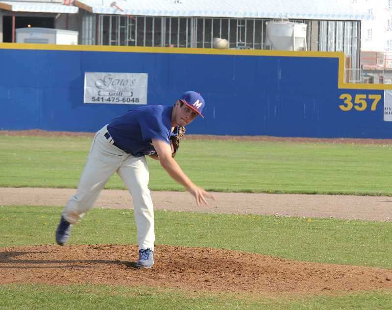 by: JEFF WILSON/THE PIONEER - Madras pitcher Ethan Short has had some strong outings as of late, but errors haven't helped the White Buffalos find that first Tri-Valley Conference victory.
