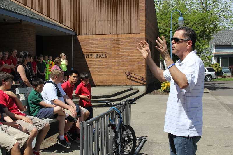 by: LINDSAY KEEFER - Thursday's event at city hall was led by Luis Molina, pastor of Woodburn Foursquare Church.