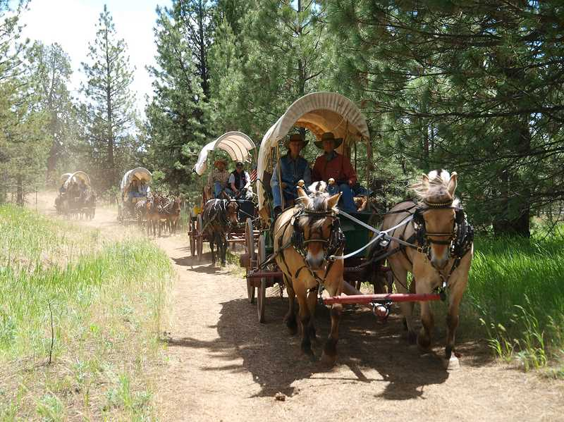 by: COURTESY PHOTO: LEE WIREN - Wagon Train participants often sing while walking the trails.