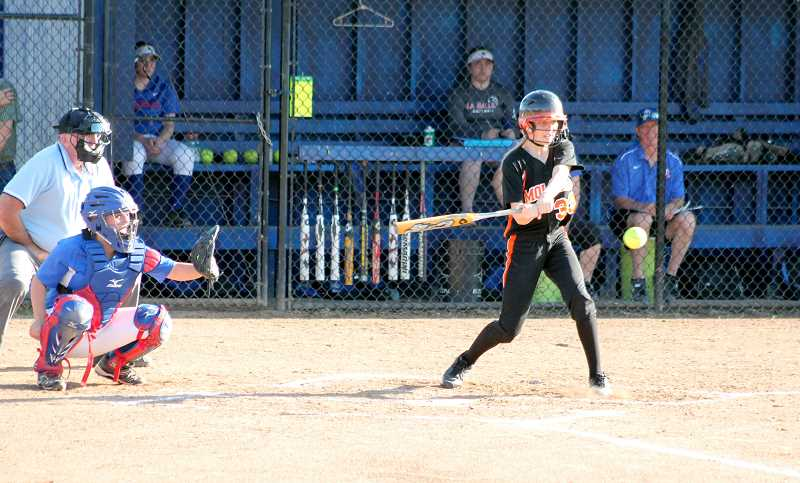by: JIM BESEDA/MOLALLA PIONEER - Molalla sophomore Amanda Clarizio eyes a pitch during last week's Tri-Valley Conference game at La Salle Prep in Milwaukie. Molalla lost 11-1 in six innings.