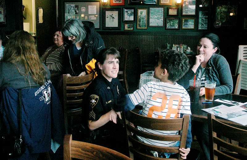 by: GARY ALLEN - For a good cause - Every year officers, such as Sgt. Gwen Johns (above), work alongside wait staff at Lil' Cooperstown Pub to raise money for the Special Olympics. This year the event takes place May 23.