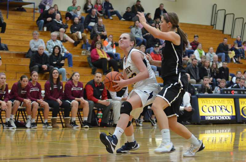 by: JEFF GOODMAN / PAMPLIN MEDIA GROUP - Canby guard Bailey Raines, whose senior season was cut short by a severe knee injury, will continue her basketball career at Pacific Lutheran University.