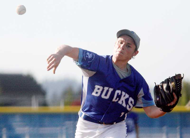 by: PHIL HAWKINS - Games split - Austin McClister tosses a pitch during St. Paul's 12-1 loss to Country Christian April 30. The Bucks rebounded Friday to beat East Linn Christian Academy 12-3.