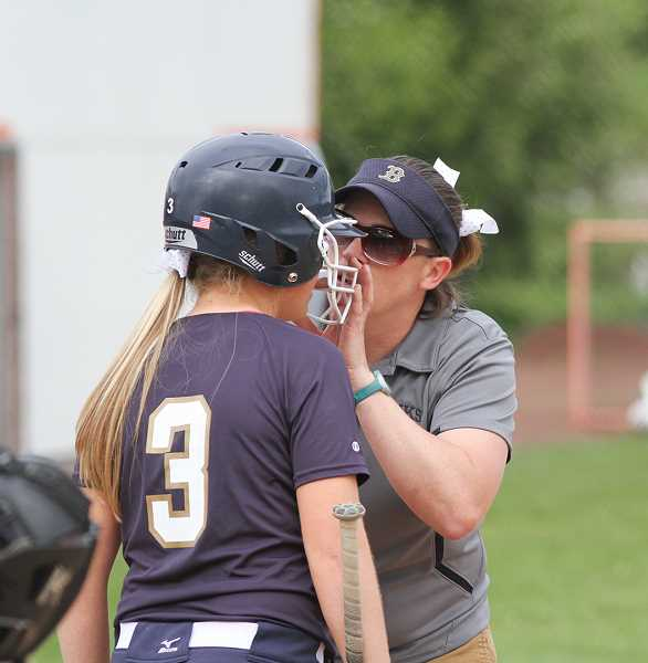 by: NEWS-TIMES PHOTO: AMANDA MILES - Banks softball coach Jenny Compton discusses strategy with junior JoJo Wren.