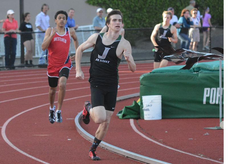 by: TIMES PHOTO: MATT SINGLEDECKER - Jesuit senior Sam Remington won the 800-meter dash against Westview on May 1, and helped the Crusader boys track team take down the Wildcats