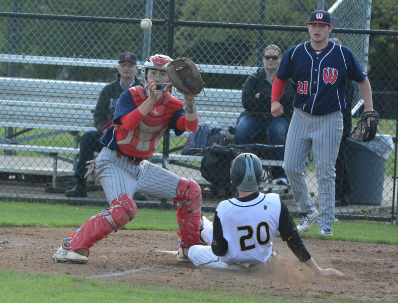 by: TIMES PHOTO: MATT SINGLEDECKER - Westview catcher Tyler Stofiel looks in a relay throw at the plate as Southridges Matthew Orcutt slides safely under the tag in the second inning on Tuesday.