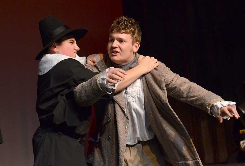 by: REVIEW PHOTO: VERN UYETAKE - Michael Fain (Mr. Willard) holds back Nathan Walker (Giles Corey) while practicing one of the many dramatic scenes in 'The Crucible.'