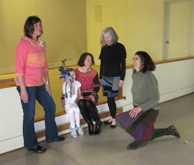 by: TIMES PHOTO: BARBARA SHERMAN - Modeling some of Dana Murphy's up-cycled and hand-painted clothing that will be worn and for sale at Saturday's Wearable Art Fashion Show fundraiser for the Bethlehem House of Bread are (from left) Kate Kelleher, Maddie Miller, 6, Dana Miller, Gail Watkins and Murphy.