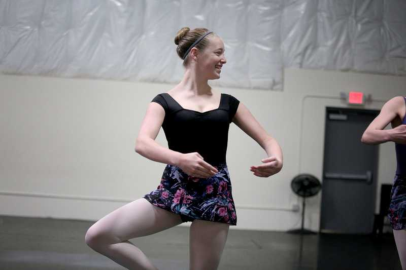 by: TIMES PHOTO: JONATHAN HOUSE - Megan Gordon stays loose during a rehearsal of 'Alice in Wonderland.'
